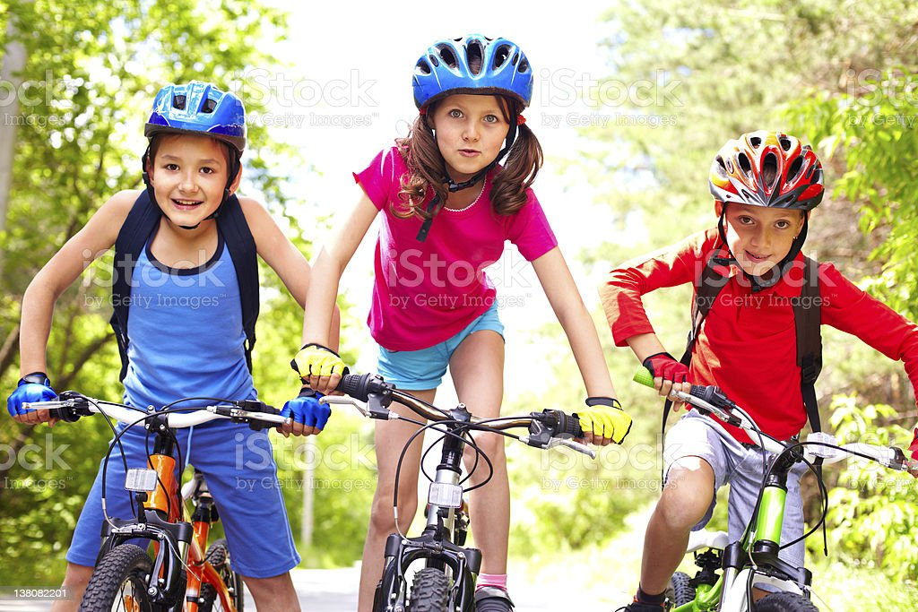 Children on bikes stock photo