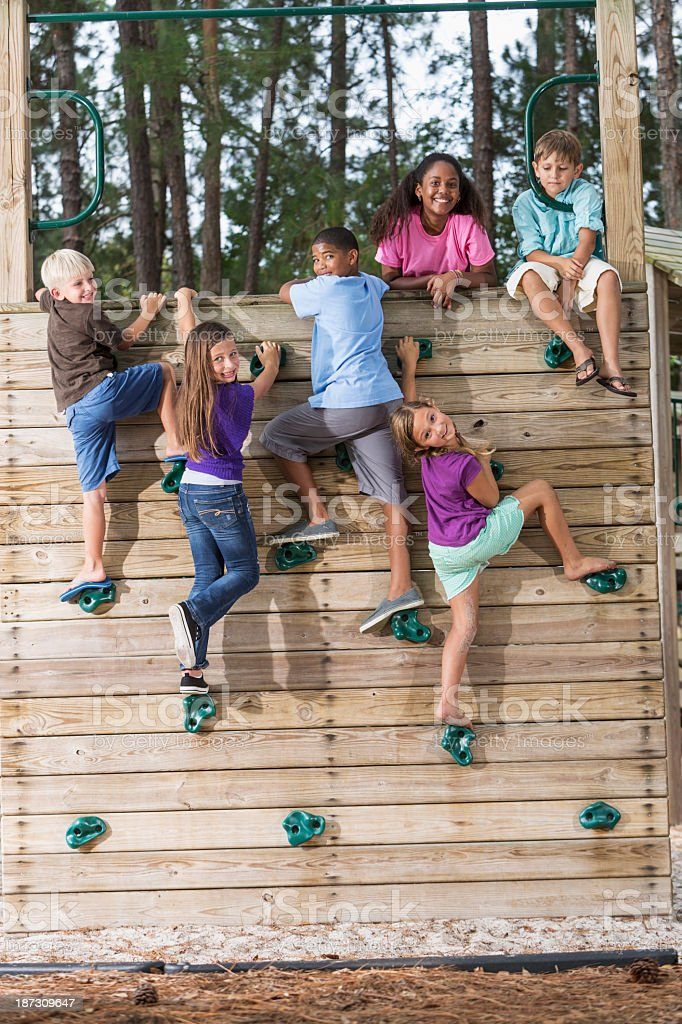 Children on climbing wall stock photo