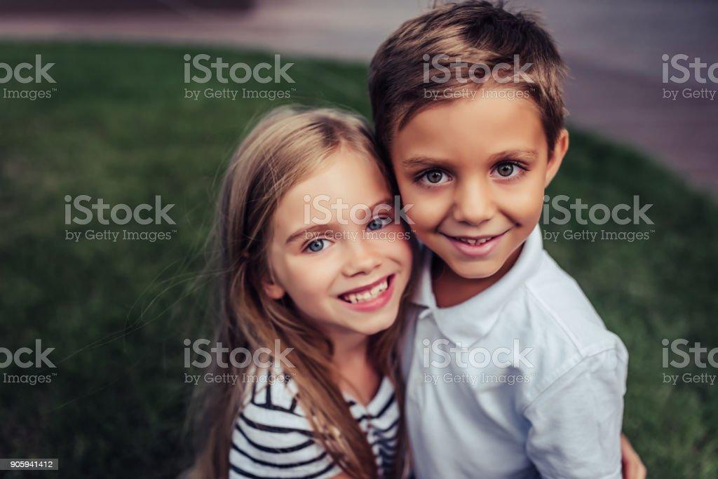 Children on green grass stock photo