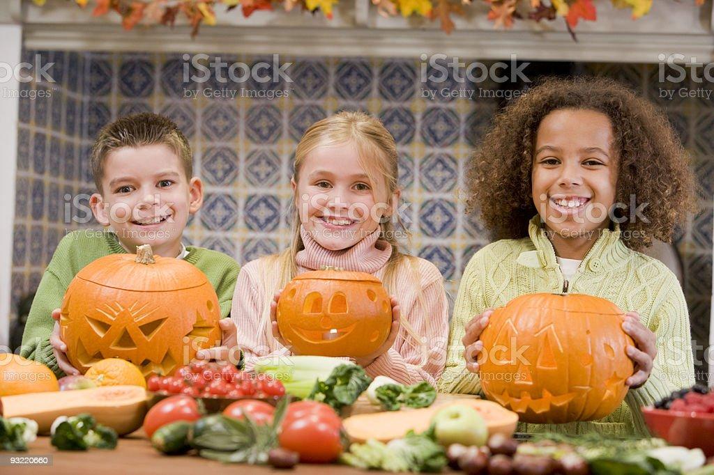 Children on Halloween with jack o lanterns stock photo