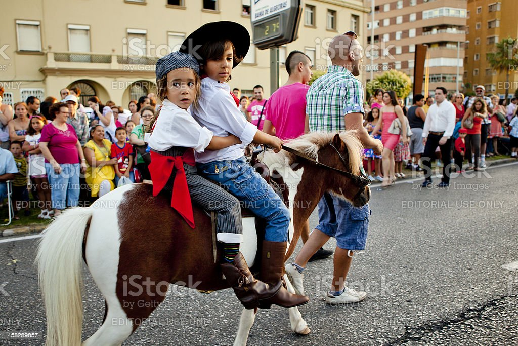 Children on Pony in Andalusian Spring Parade royalty-free stock photo