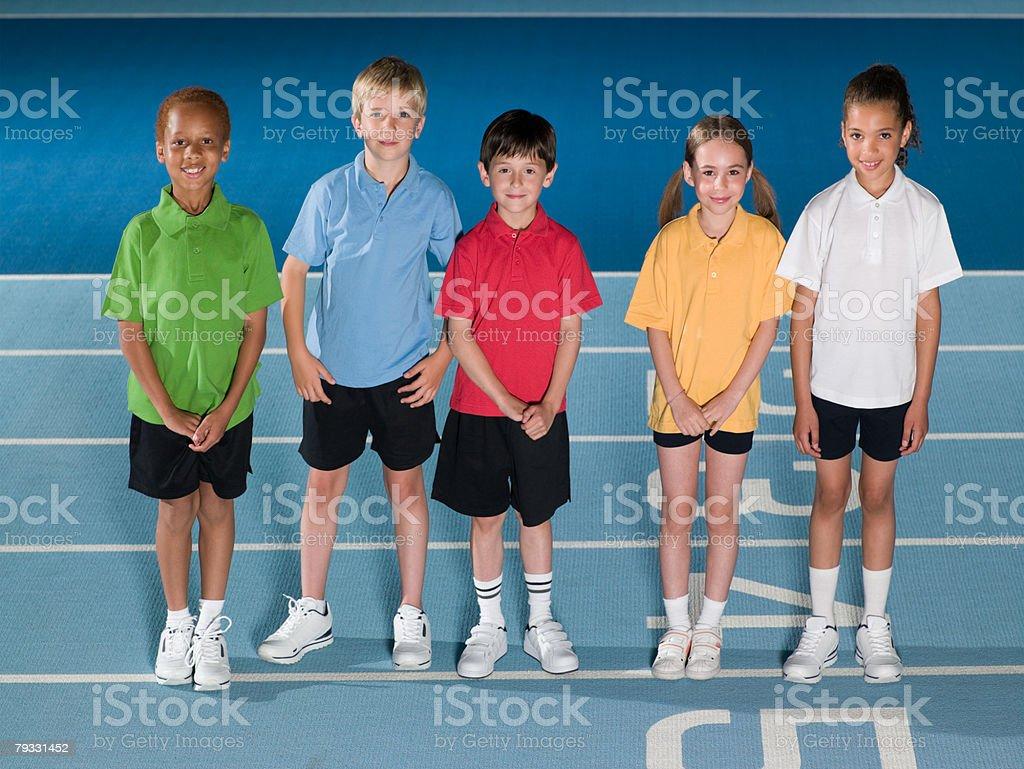 Children on running track 免版稅 stock photo