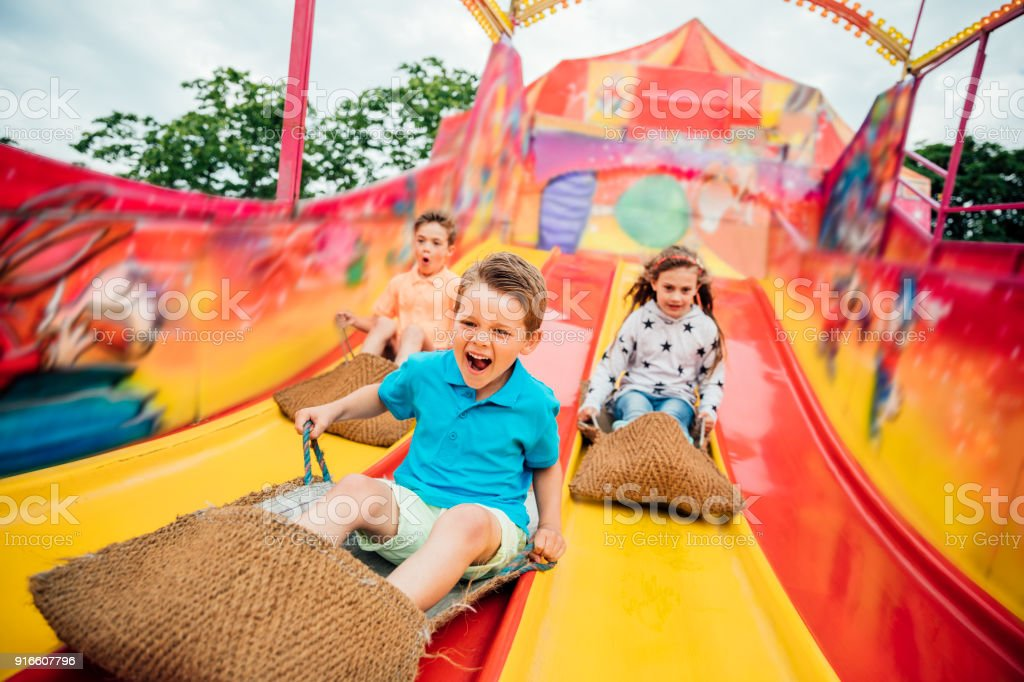 Children on Slide at a Funfair stock photo
