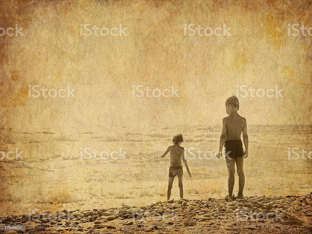 children on the beach - old photo stock photo