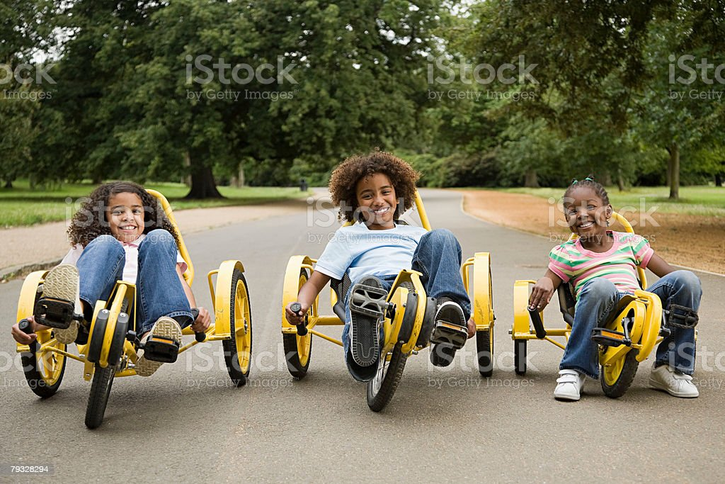 Children on tricycles royalty-free 스톡 사진