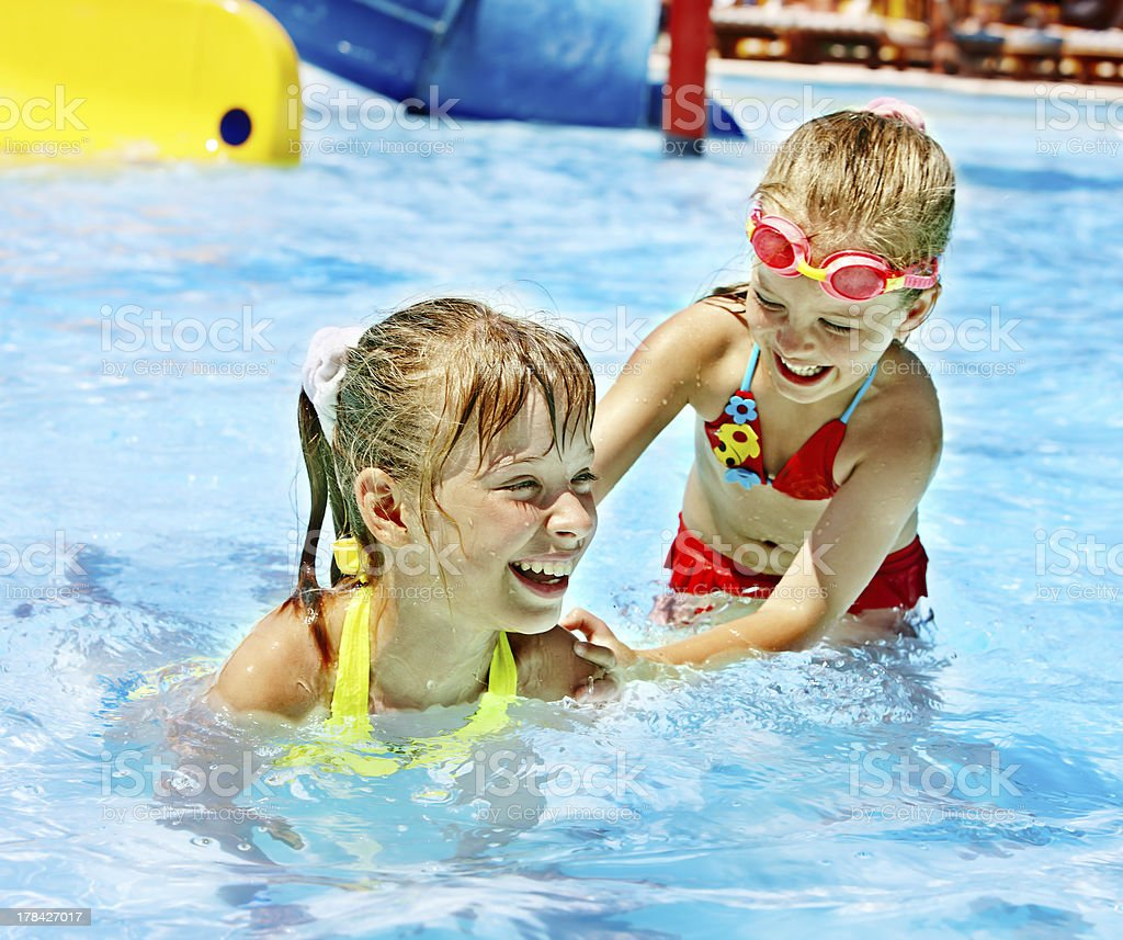 Children on water slide at aquapark. stock photo