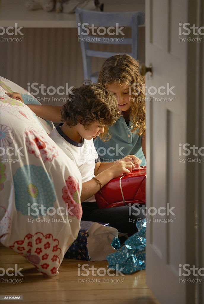 Children opening Christmas gifts royalty-free stock photo