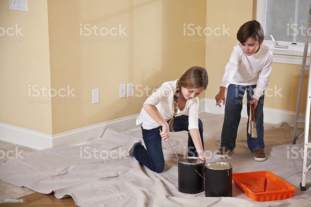 Children opening paint cans stock photo