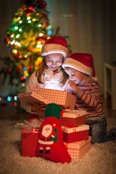 Best Family Opening Christmas Gifts Stock Photos, Pictures ...