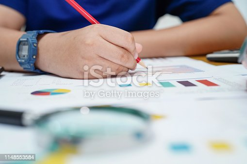 istock Children or kid calculate mathematics with pencil about math with graph : education study learning school concept 1148553584
