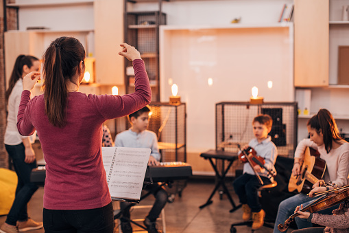 Children orchestra in music school