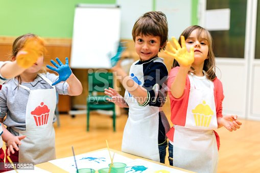 istock Children Painting Their Hands With Watercolors 598155822
