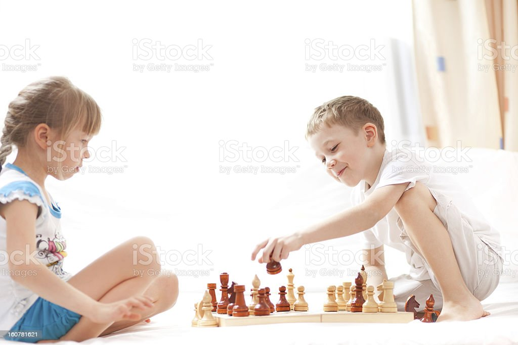 Children palying chess royalty-free stock photo