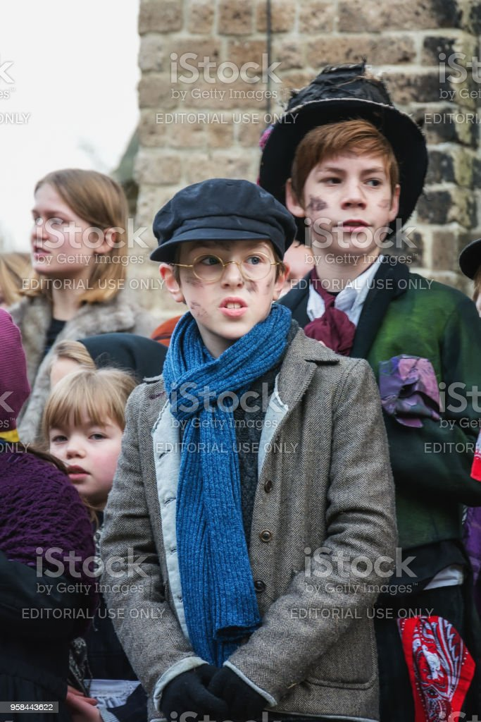 Children perform in a musical during the Dickens Festival stock photo