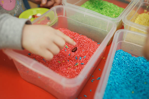 Children play educational games with a sensory bin in kindergarten Children play educational games with a sensory bin in kindergarten. sensory perception stock pictures, royalty-free photos & images
