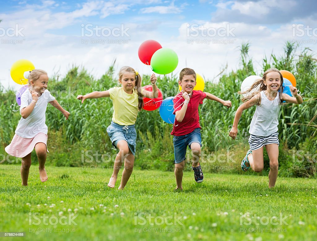 Children play games with ballons stock photo