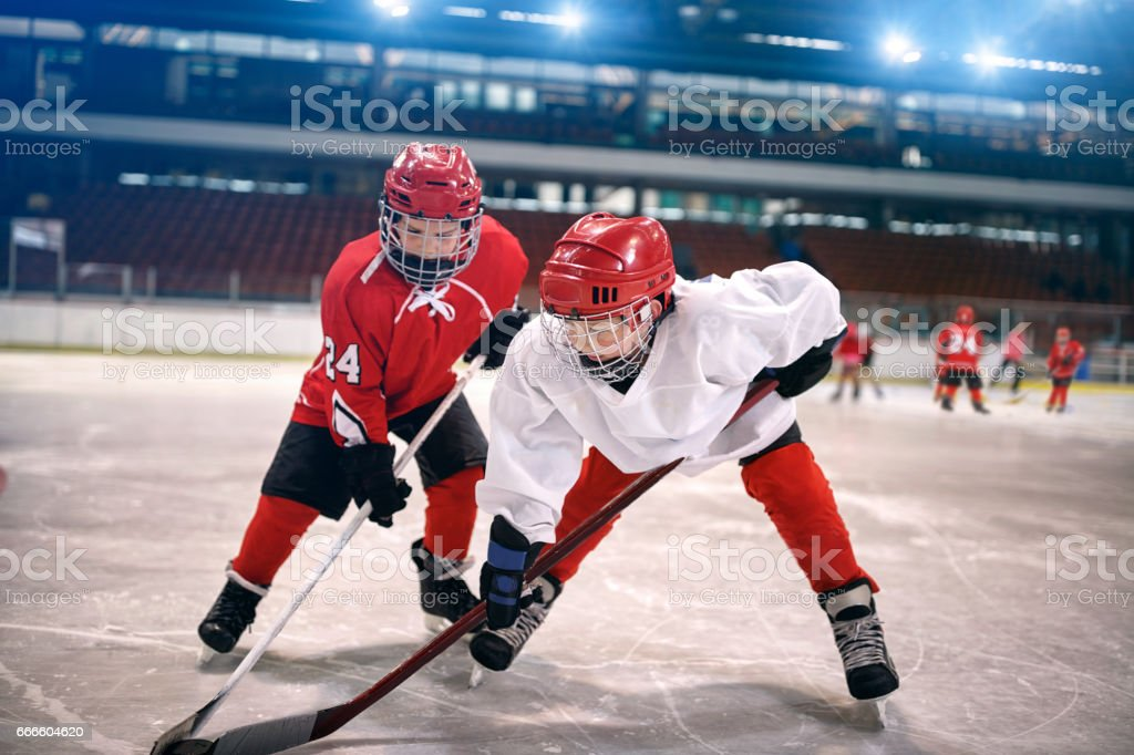 children play ice hockey stock photo