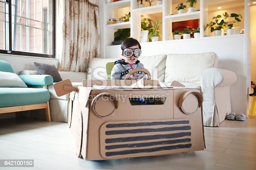 istock Children play in the cardboard car 642100150