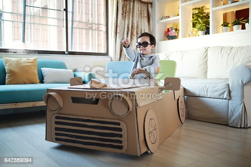 496487362 istock photo Children play in the cardboard car 642389094