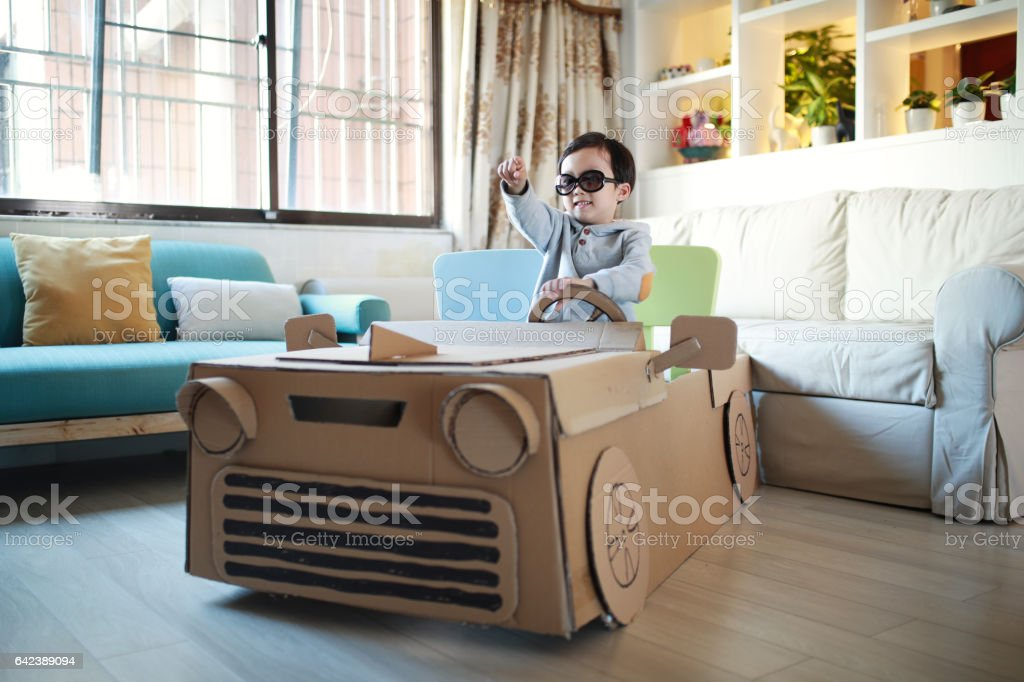 Children play in the cardboard car stock photo