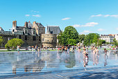 The photo was taken on July 14, 2017 on the Day of the Bastille in Nantes, France. This fountain is located in front of the Breton Fortress in the city center.