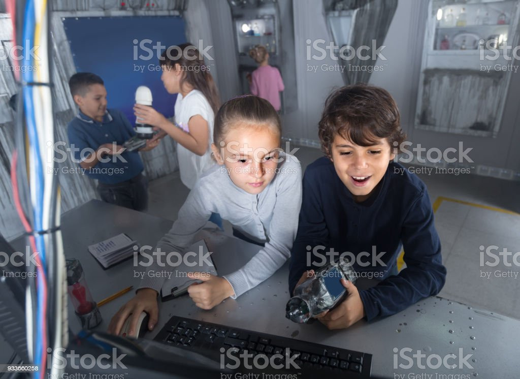 children play in the quest room of a inscrutable bunker stock photo