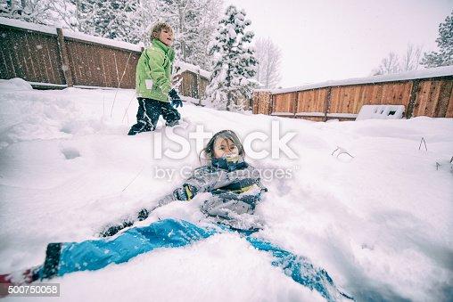 865399512istockphoto Children play in the snow 500750058