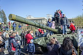KRASNOYARSK, RF - May 9, 2013: Children play on the tank on the central square of Krasnoyarsk among the exhibition of artillery big guns, during the celebration of Victory Day WWII. Krasnoyarsk. Krasnoyarsk Region. Russia.