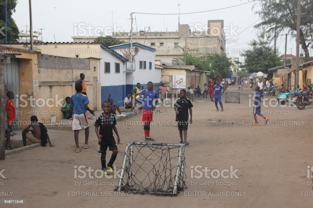 Children play Soccer, Roads of Lomé, Togo, West Africa - Photo