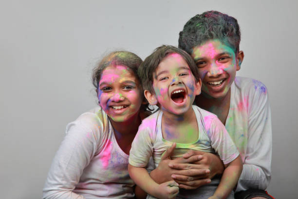 Children play with Holi festival colours stock photo