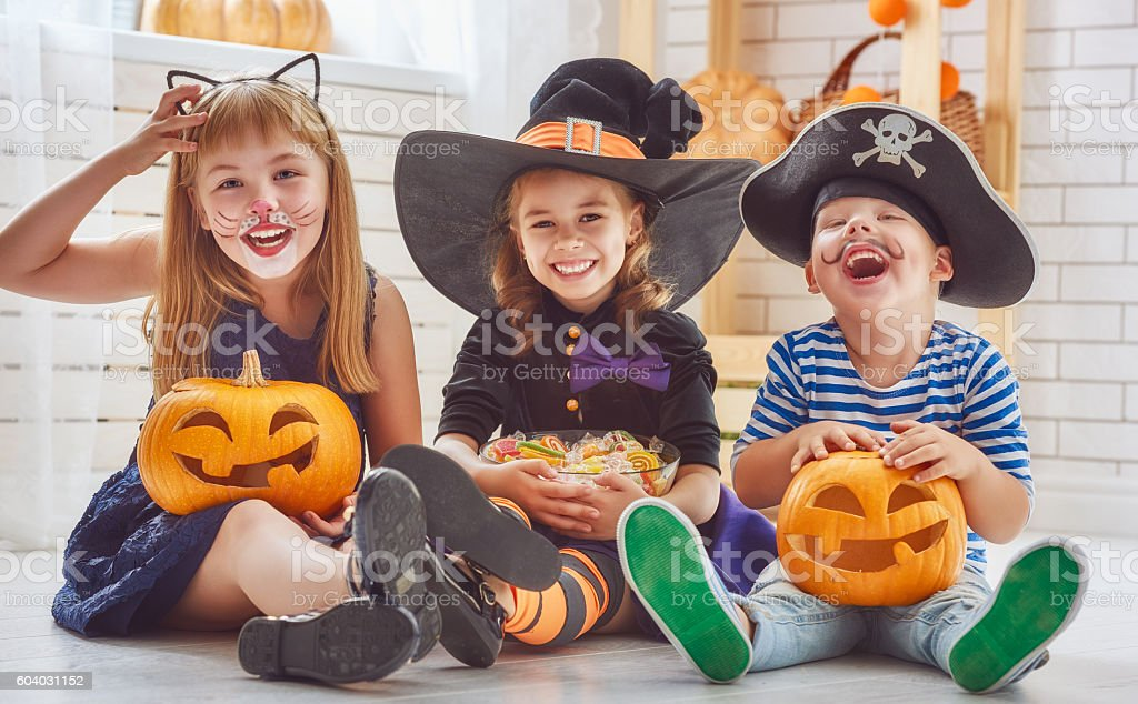 children play with pumpkins stock photo