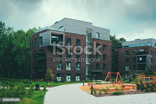 1165384568 istock photo Children playground with modern residential buildings quarter 949098390