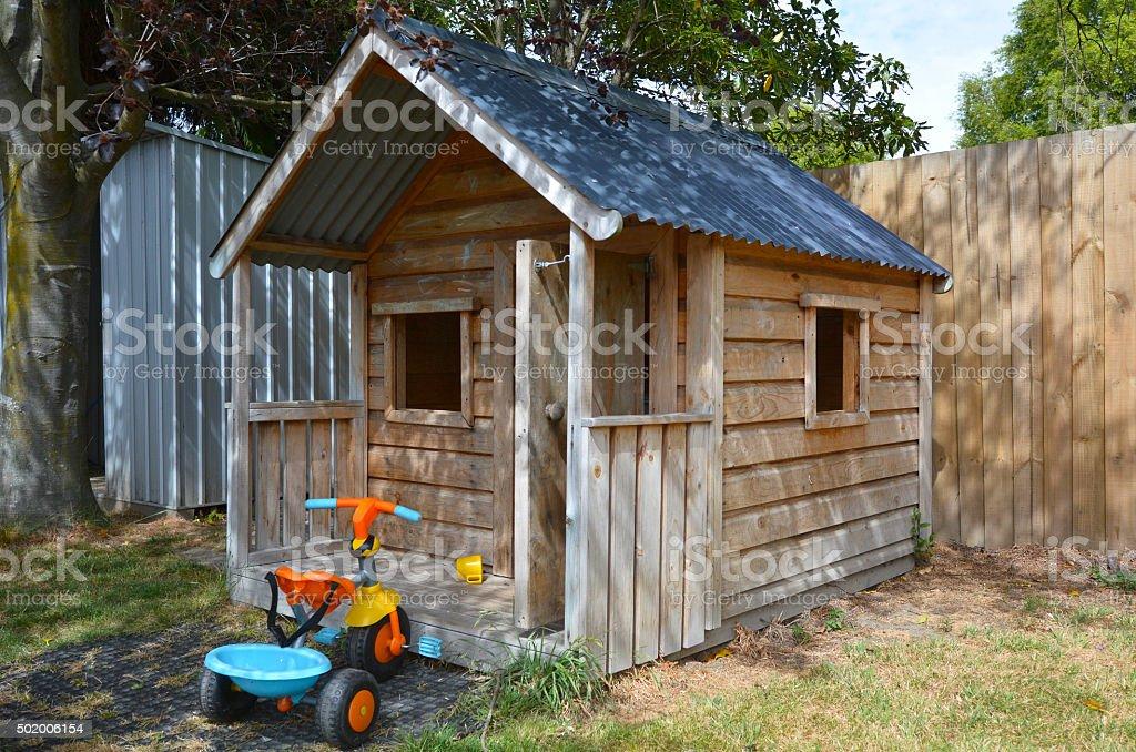 Children playhouse in the yard stock photo