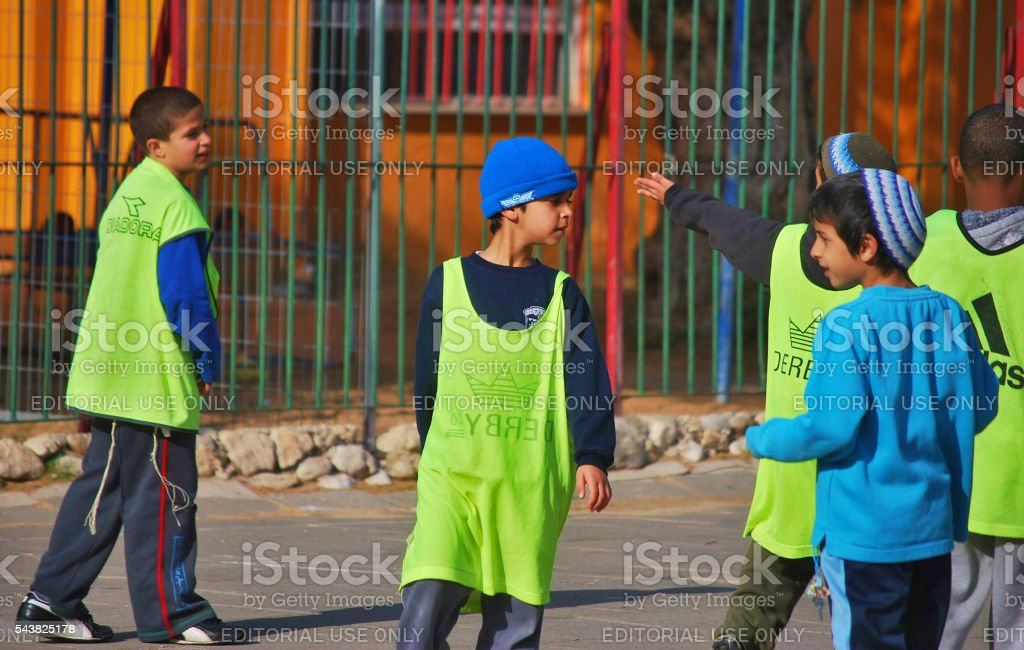 Children playing a team sport, Tel Aviv, Israel stock photo