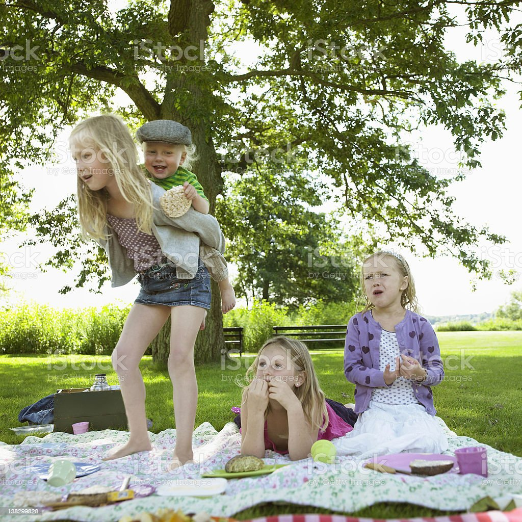 Children playing at picnic stock photo