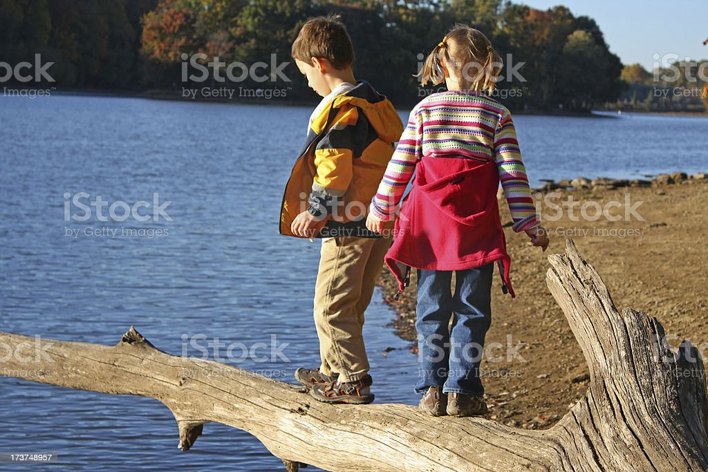 Children playing at the lake royalty-free stock photo