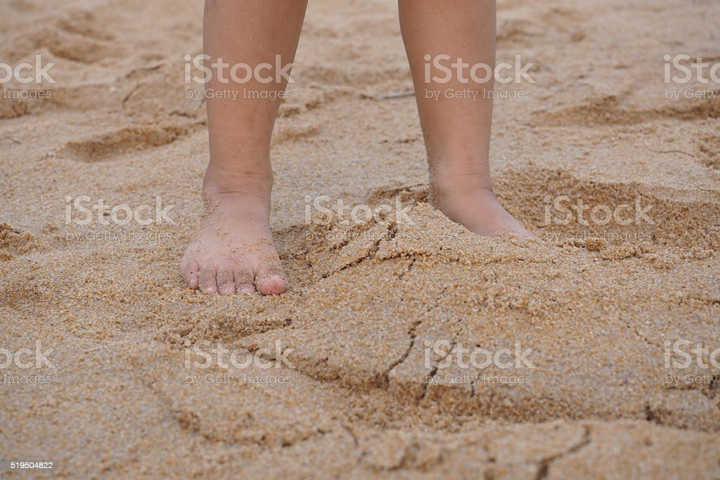 Children playing bare feet on the sand on the beach stok fotoğrafı
