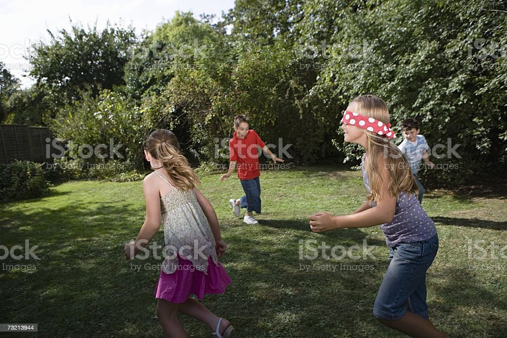 Children playing blind mans bluff stock photo