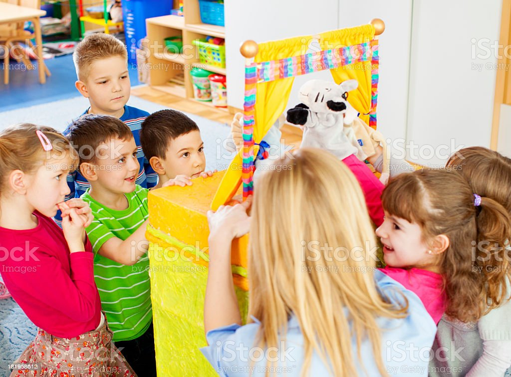Children Playing Finger Puppet Show. stock photo