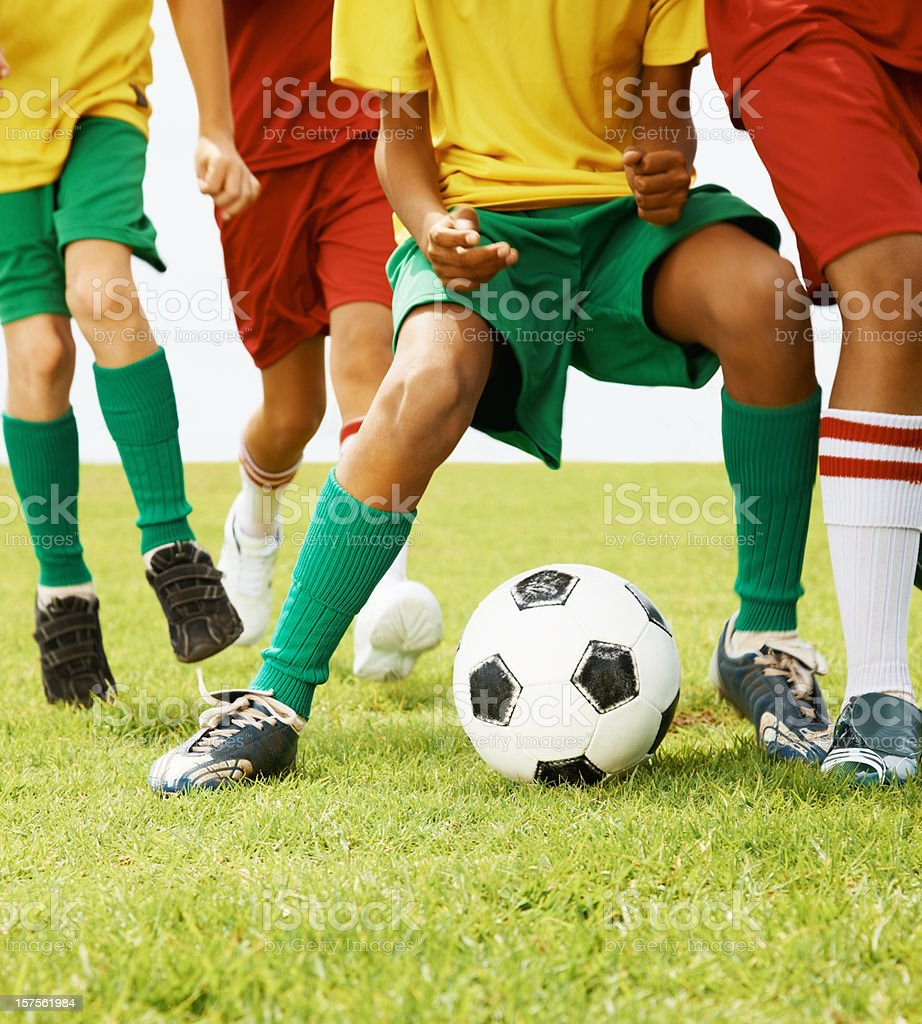 Children playing football in a park royalty-free stock photo