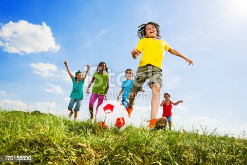 544818734 istock photo Children playing football in the field. 170155830
