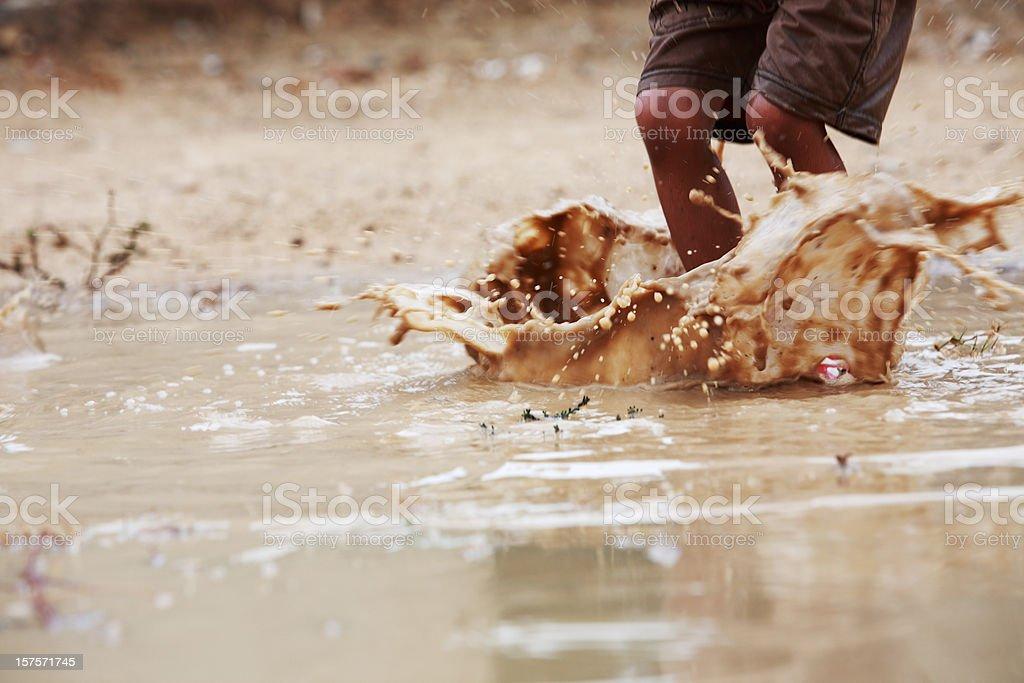 Children Playing Freedom Rainwater Puddle Splashing stock photo