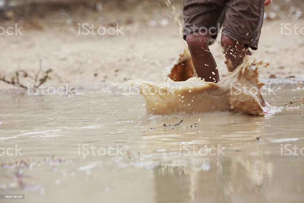 Children Playing Freedom Rainwater Puddle Splashing royalty-free stock photo