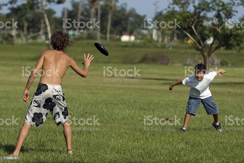 children playing frisbee royalty-free stock photo