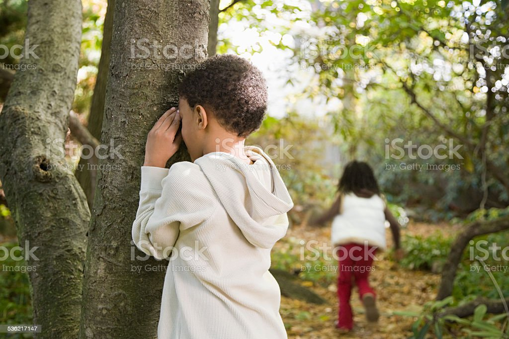 Children playing hide and seek stock photo