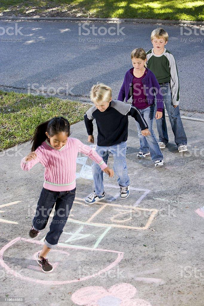 Children playing hopscotch stock photo