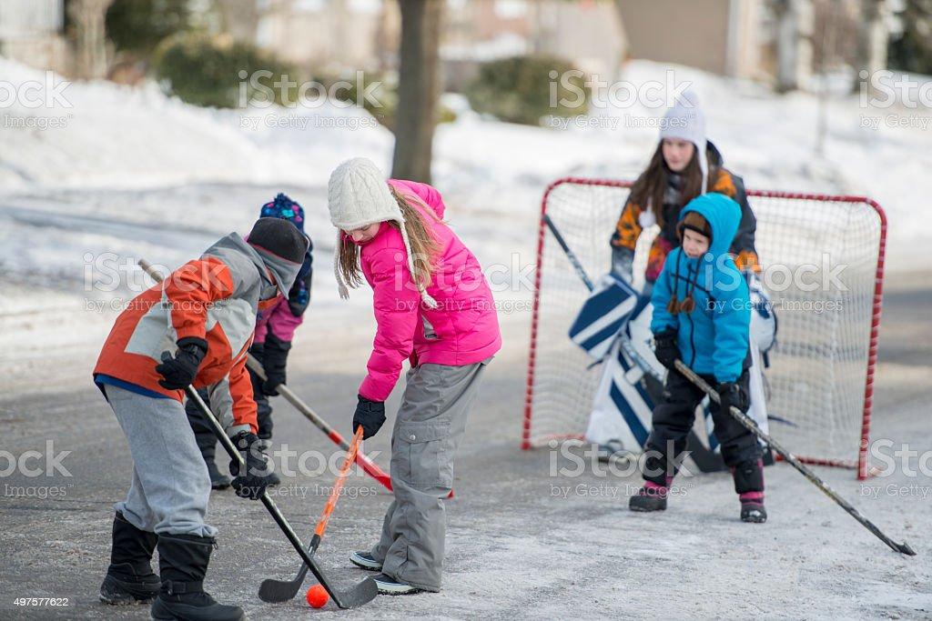 Children Playing Ice Hockey stock photo