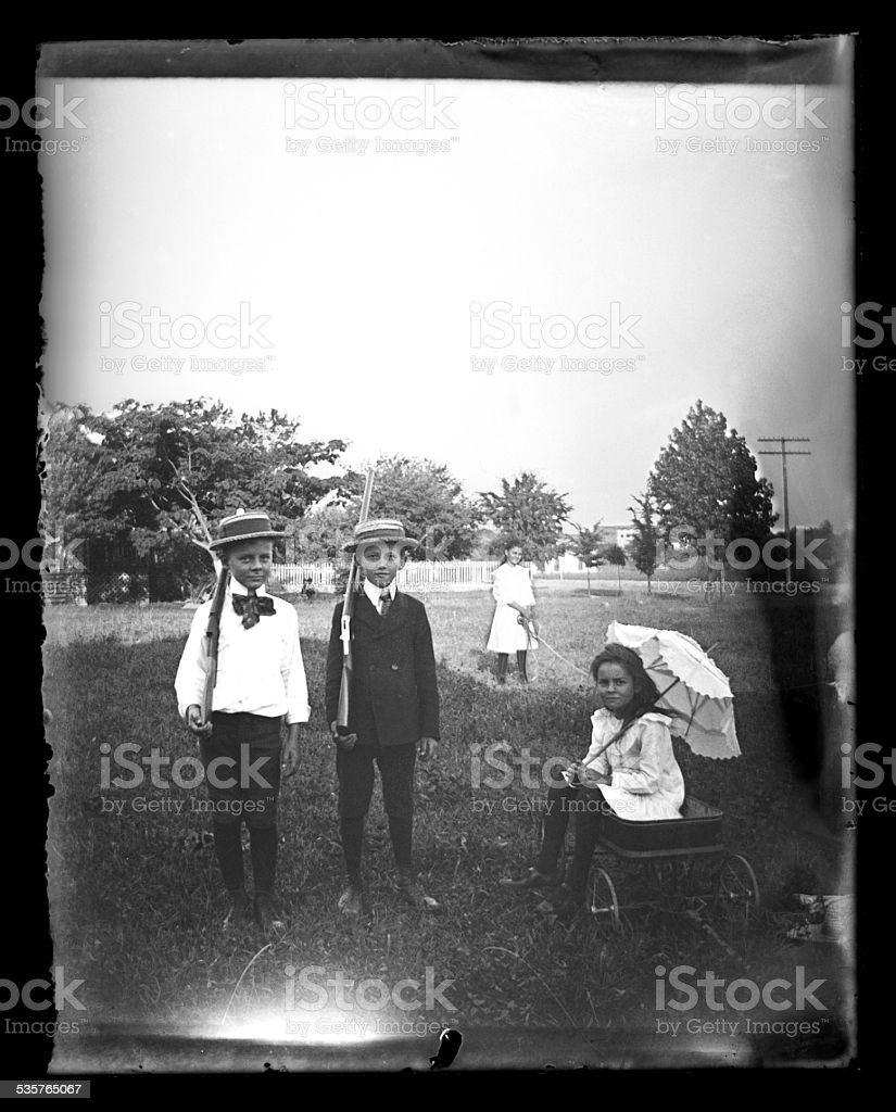 Children Playing in a Field, Circa 1890 stock photo