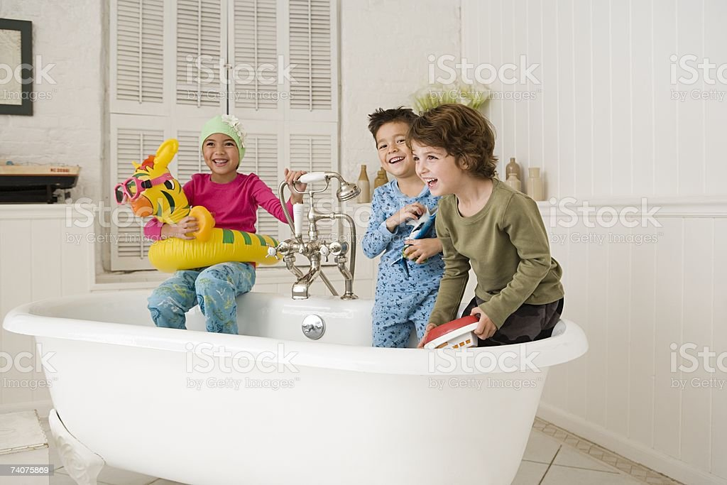 Children playing in bath tub stock photo