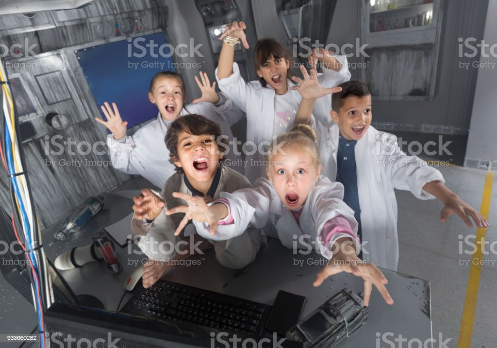 Children playing in bunker quest room stock photo